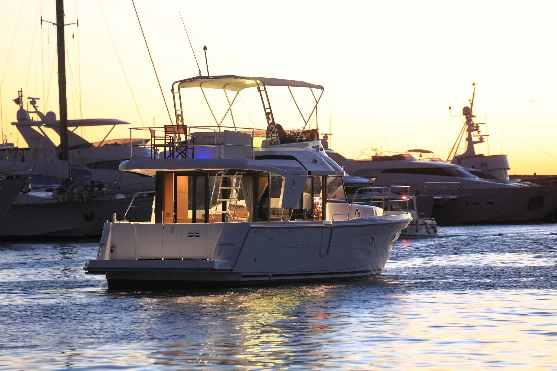 Beneteau Swift Trawler 35 running sunset